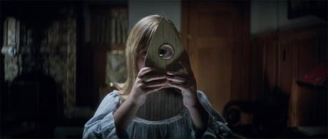 Doris looking through Quija planchette